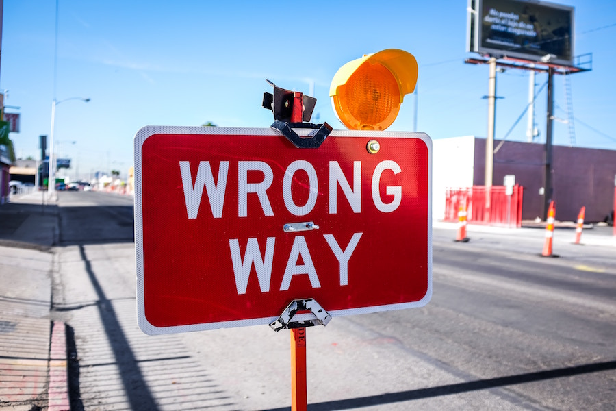 Road sign saying 'Wrong Way'. Photo by Neon Brand at Unsplash.